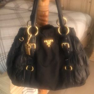 Authentic Prada handbags.